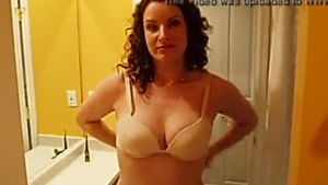Jennifer White took off her red shirt and bra to show her new bra she wants to give me