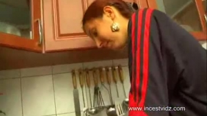 Redhead teen sucking and getting fucked in the kitchen