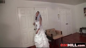 Skinny tattooed plumper with small tits is wearing her wedding dress and getting ready to ride cock